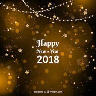 Fundo dourado de ano novo com estrelas com efeito bokeh