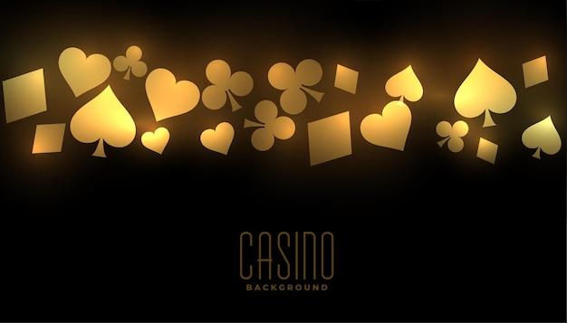 Fundo dourado de cassino com símbolos de naipe de cartas