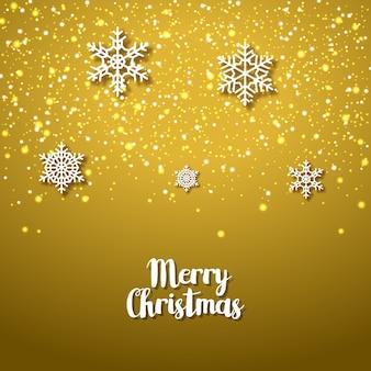 Fundo dourado festivo com flocos de neve. temporada festiva de natal do feriado de inverno de natal. cartão de aniversário.
