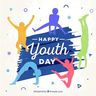 Fundo feliz do dia da juventude com silhuetas coloridas