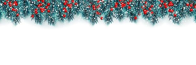 Fundo festivo de natal ou ano novo. galhos de árvores de natal com bagas de azevinho e neve de natal. fundo do feriado.