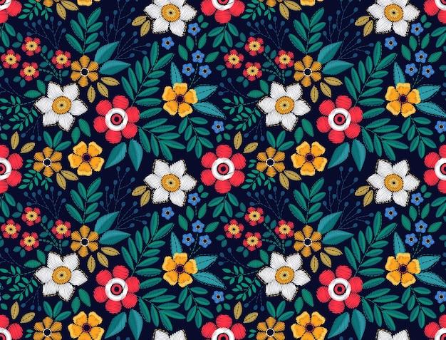 Fundo floral em estilo vintage. padrão sem emenda. flores decorativas bordadas. ornamento para têxteis em fundo preto. o elegante modelo para estampas de moda.