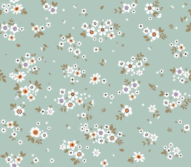 Fundo floral vintage padrão de vetor sem costura com flores pequenas em um fundo azul claro