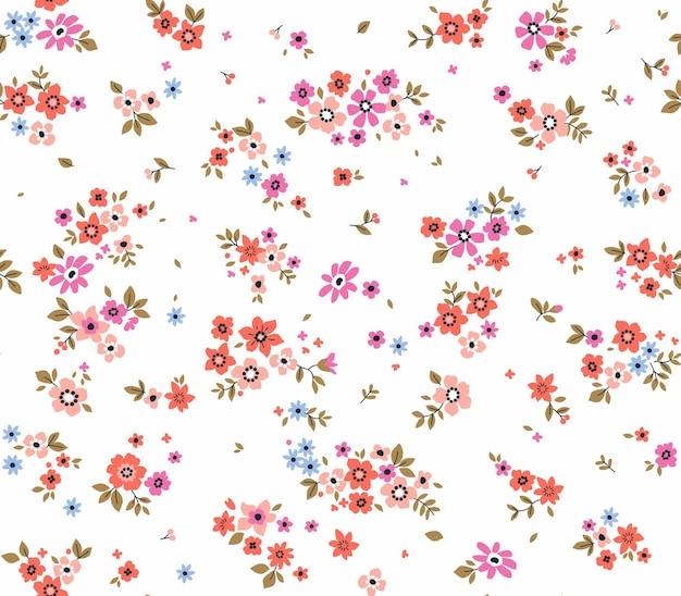 Fundo floral vintage padrão de vetor sem costura com flores pequenas em um fundo branco