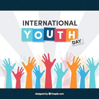 Fundo internacional do dia da juventude com mãos coloridas