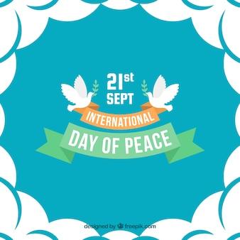 Fundo internacional do dia da paz com pombos e fitas