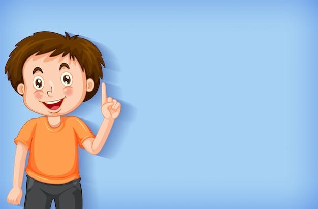 Fundo liso com menino apontando o dedo