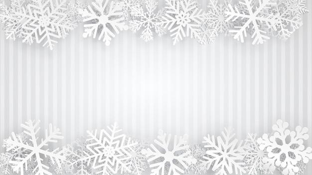 Fundo listrado em cores cinza com flocos de neve brancos