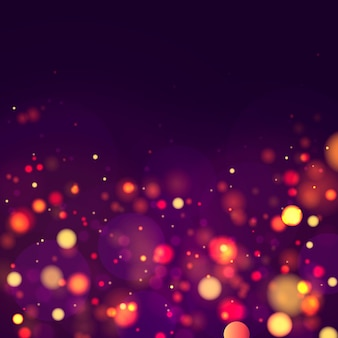 Fundo luminoso festivo azul, roxo e dourado com luzes coloridas bokeh.