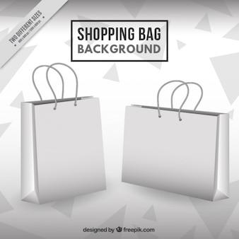Fundo monocromático com triângulos e sacos de compras