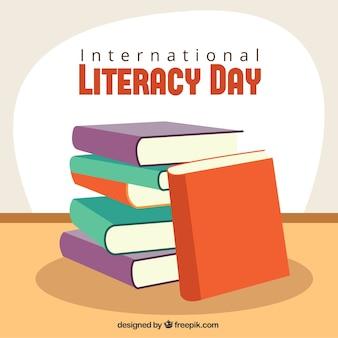 Fundo pilha de livros para o dia de alfabetização