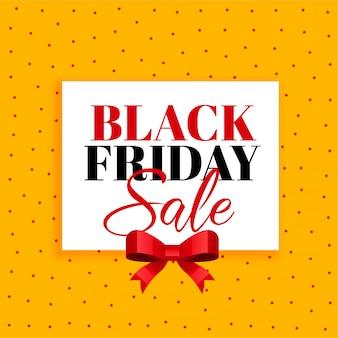 Fundo preto de venda sexta-feira com fita vermelha