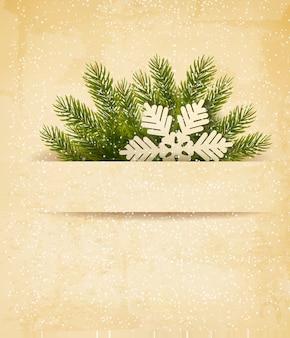 Fundo retrô de natal com galhos de árvores e floco de neve