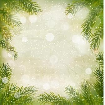 Fundo retrô de natal com galhos de árvores e flocos de neve. .