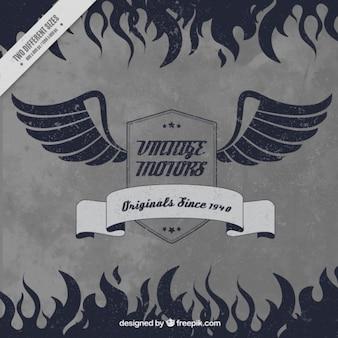 Fundo retro do emblema da motocicleta com asas e chamas