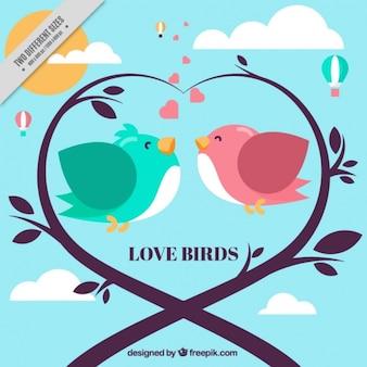 Fundo romântico com pássaros e coração feito de ramos