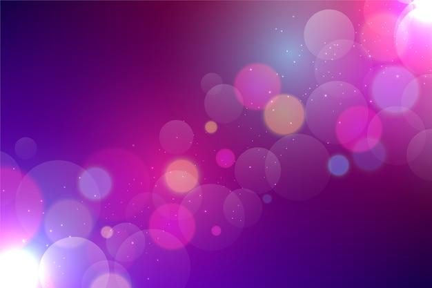 Fundo roxo bokeh com partículas brilhantes