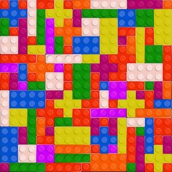 Fundo sem emenda de alta qualidade de tijolos de plástico coloridos.