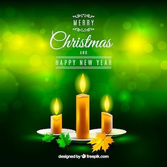 Fundo verde de natal com velas realistas