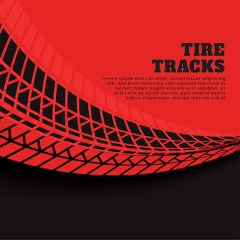 Fundo vermelho com impressões de pista de pneu