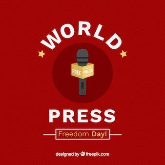 Fundo vermelho com microfone para o dia da liberdade de imprensa mundial