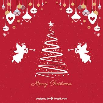 Fundo vermelho com silhuetas de uma árvore de natal e anjos