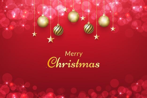Fundo vermelho de natal com enfeites de ouro e efeito bokeh brilhante.