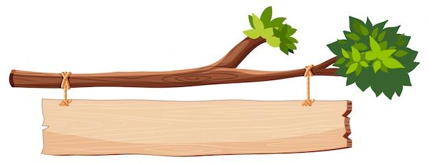 Galho de árvore com placa de madeira