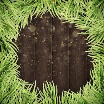 Galhos de árvores de natal com fundo de madeira.