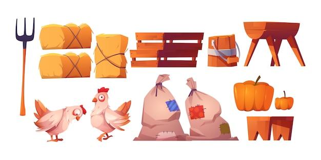 Galinhas, palha, sacos com colheita e garfo