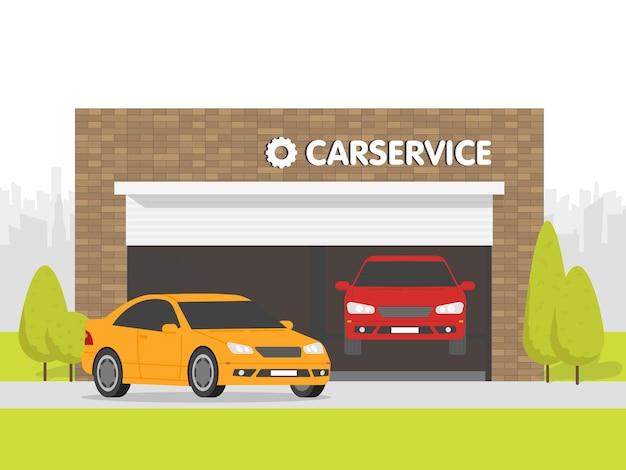 Garagem de oficina de automóveis. o carro no fundo do prédio de tijolos. espaço urbano ao fundo.