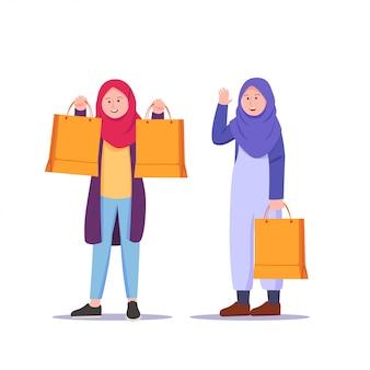 Garota adolescente vestindo cartoon de compras hijab