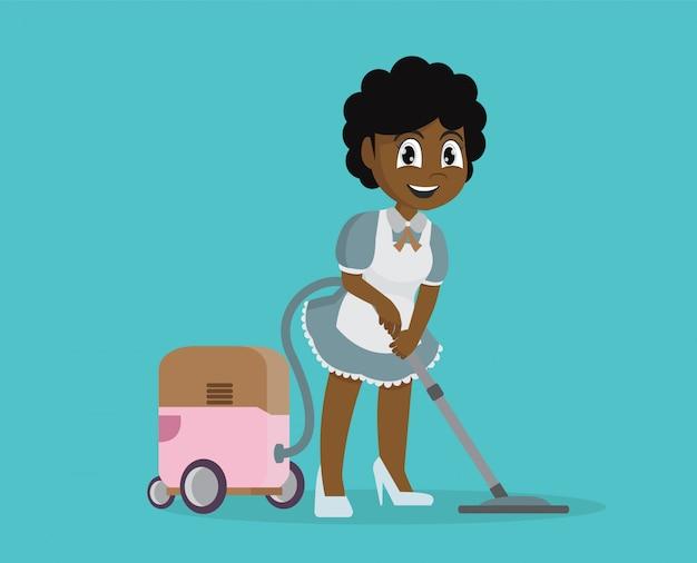 Garota africana usando aspirador para limpar a casa.