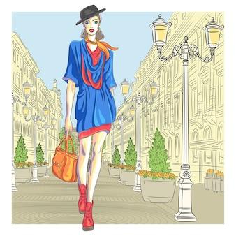 Garota atraente da moda em chapéu com bolsa em estilo de desenho vai para são petersburgo