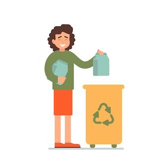 Garota coleta de garrafas de papel em uma lixeira para reciclagem