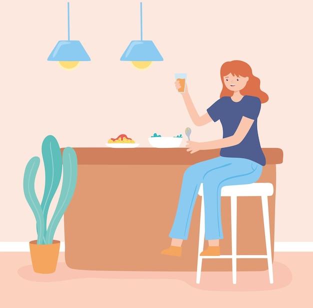 Garota comendo na cozinha