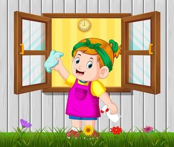 Garota de atividade diária, limpando a janela de manhã