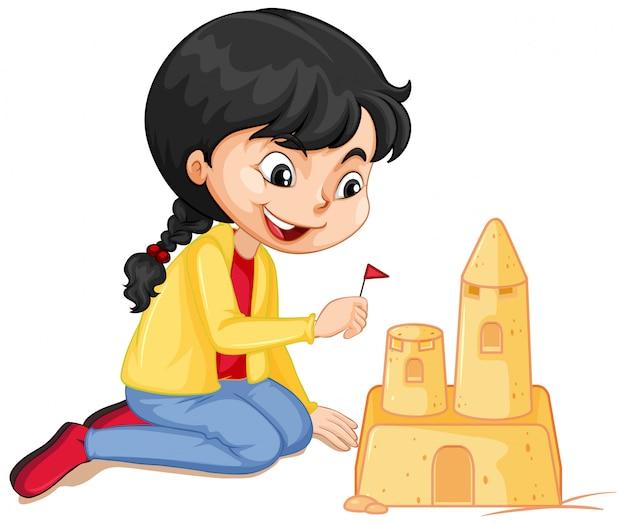 Garota de jaqueta amarela fazendo castelo de areia em branco