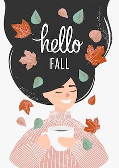 Garota de um suéter rosa bebe uma xícara de chá ou café com folhas de outono