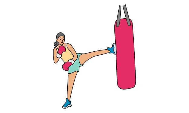 Garota esportiva fazendo exercícios de muay thai com um saco de areia de boxe ajoelhado