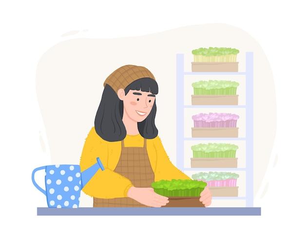 Garota feliz com caixas de microgreens. cultivando superalimento em casa. mulher com um regador.
