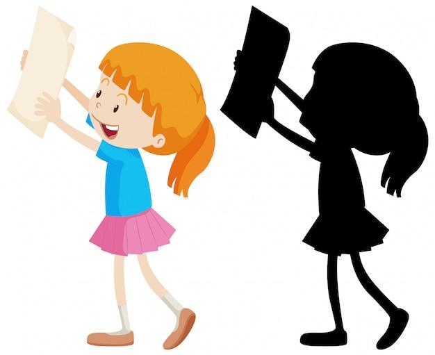 Garota feliz, segurando o papel com sua silhueta
