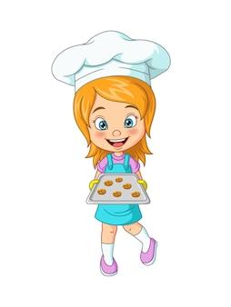Garota fofa chef de padaria segurando uma bandeja com biscoitos