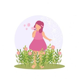Garota garoto bonito de primavera jogando flor e bolha no jardim