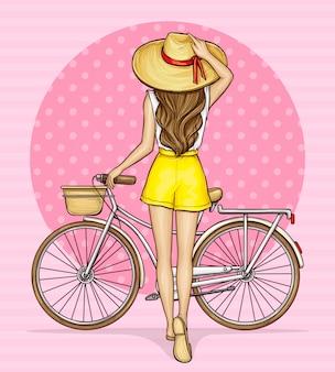 Garota pop art perto de bicicleta com cesta