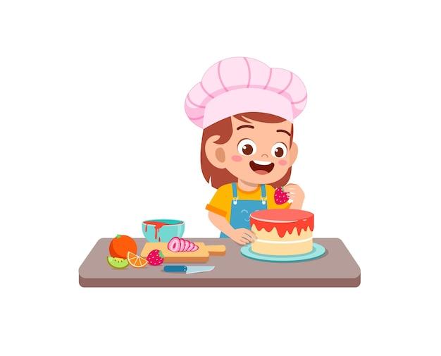 Garotinha feliz e fofa usando uniforme de chef e cozinhando um bolo de aniversário