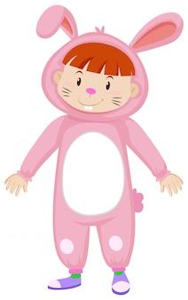 Garoto bonito em traje de coelho rosa