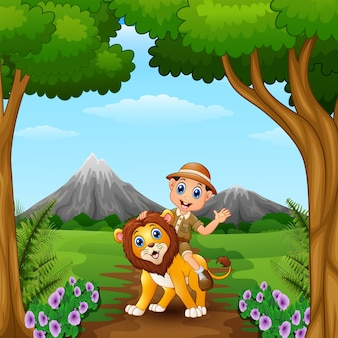 Garoto do zoológico e um leão na selva