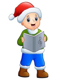 Garoto feliz cantando canções de natal acenando
