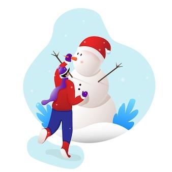 Garoto feliz construindo um boneco de neve fora do inverno